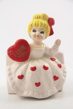 "Vintage Relpo ceramic Valentine's Day planter Stands approx. 5 1/2"" high Features a blond hair girl holding an ""I Love you"" red heart Signed, numbered & with sticker. 