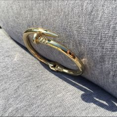 Clavo FREE WITH THE PURCHES OF $70 or more Clavo bangle new without tag... Have a few left questions comment below 👇 gold plated great quality... Price is FIRM Jewelry Bracelets