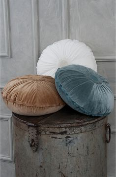 Each of these sumptuous round cushions is made from gathered cotton velvet decorated with a beautiful central cluster of tiny hand embroidered knots and a raw silk edge.