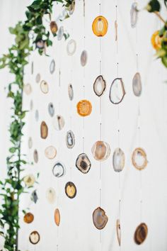 It doesn't get much cooler or more creative than these hanging agate slices.     Image via  June Bug Weddings.
