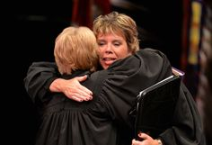 Minnesota Supreme Court Associate Justice Anne McKeig gives Chief Justice Lorie Gildea a hug after being sworn in at her investiture ceremony. As the 94th Associate Justice of the Minnesota Supreme Court McKeig is the first Native American judge to rise to the Minnesota Supreme Court and the first female Native American to serve on any state's high court.