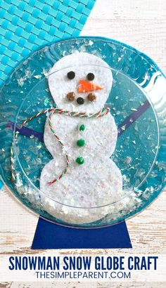 Snowman Snow Globe Craft - This easy DIY craft for kids is perfect for preschool through kindergarten. Older kids can help out too! You can use pom poms, ribbon, and leftover craft supplies to decorate the snowman!