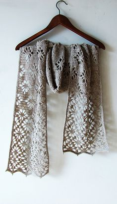 Crochet scarf with lacy edges. Fingering weight (sock weight) yarn. Pattern has written row-by-row instructions and chart. $5.00 on Ravelry.