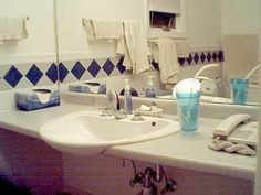 wheelchair accessible sinks - Google Search  This style sink would be good for Dad for when he is brushing teeth since it hangs out over counter