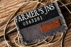 Screen printed fabric with hot printed leather label made in Italy by Panama Trimmings #denim #details #vintage #labeling