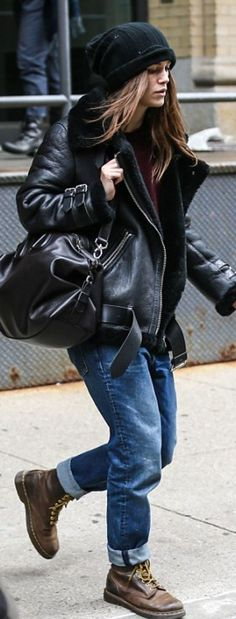 Who made  Keira Knightley's shearling jacket, brown boots, and black leather handbag?