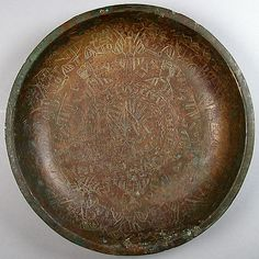 Engraved Bowl Date: ca. 1130 Culture: Netherlandish Medium: Copper alloy, wrought Dimensions: Overall: 10 7/16 x 1 7/8 in. (26.5 x 4.8 cm) Classification: Metalwork Accession Number: 65.89 The Metropolitan Museum of Art