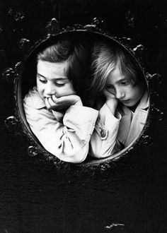 Gerry Cranham :: Seeking A Home. Twins Renate and Innes Spanier (German-Jewish refugees) gaze out of a porthole of the liner 'St Louis' as it finally arrives at Antwerp, after being refused entry to Cuba, the US and Canada, prior to the start of WW...