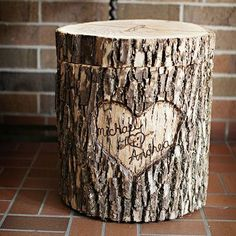 A personalized card box made from the bark of a tree stump plus 7 more DIY wedding decoration ideas: http://www.womenshealthmag.com/life/wedding-decorations?cm_mmc=Pinterest-_-WomensHealth-_-content-life-_-diyweddingdecor #weddingdecoration