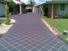 Get average costs to install concrete driveway per square foot in your area. Driveway Tiles, Driveway Design, Stencil Concrete, Painting Concrete, Bathroom Makeovers On A Budget, Concrete Patio Designs, Asphalt Driveway, Red Houses, Concrete Driveways
