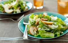 Walnut oil, creamy cheese, pears and lemon juice combine beautifully with white wine vinegar in this elegant salad.