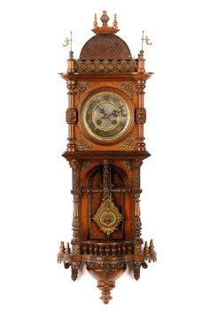 German Architectural Carved Oak Wall Clock : Lot 1025. Hammer Price: $1,600