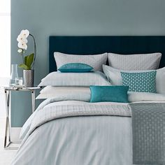 Add a touch of subtle pattern to your bed with Deauville's elegant leaf motif print coloured in softest aqua blue tones. The design is self reversing and made from wonderfully soft 300 thread count cotton sateen.