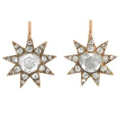 Georgian Rare Holland and Rose Cut Diamond Starburst Earrings. An absolutely breathtaking pair of diamond starburst earrings from the Late Georgian (ca1830) era! These beautiful earrings are made of 12kt rose gold and form the shape of a dazzling 9-point starburst...c1830