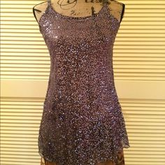 h.i.p. Shoulder Strapped Black Silver Sequined Top h.i.p. hanging in the present  Shoulder Strap Black Silver Sequence Top. Size L. Falls right below hips. Falls in Hour Glass Figure. Extremely complimentary. Not over done with sequence.  Amazingly perfect (granted this is my opinion. But I do have a good eye and have been schooled in NYC). Can be worn with a jacket if cold. If summer would look beautiful skirt, pants, even tulle skirt. Many different options on how to wear. Hand Wash gently…