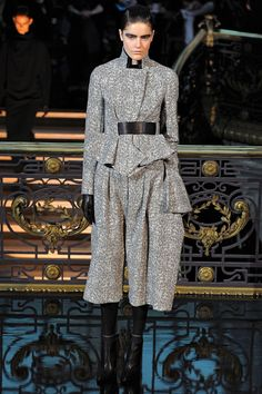 """ALL 2013 RTW  John Galliano /  The severe, linear, monochromatic collection that Bill Gaytten showed for John Galliano felt like a very deliberate repudiation of the label's legacy of languid glamour and heady romance. """"I'm not a soft, romantic person,"""" Gaytten said dismissively. """"There are no simpering sex kittens, no women who depend on men for their sense of identity.""""  the designer offered an uncompromising vision of power women so strict and disciplined it bordered on the militantly…"""