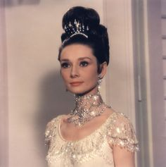 """Yes, """"Breakfast At Tiffany's"""" is usually the film that comes to mind when we think of Audrey Hepburn, fashion icon.  But the moment Eliza Doolittle appears in this stunning diamond choker, dressed for her big night at the Embassy Ball in """"My Fair Lady"""" always knocks our socks off.  --  Still of Audrey Hepburn in My Fair Lady © 1964 Warner Bros."""