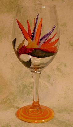 Hey, I found this really awesome Etsy listing at https://www.etsy.com/listing/181352090/hand-painted-wine-glass-bird-of-paradise