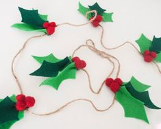 A beautiful handmade felt holly garland that is perfect for a photo prop, to place across a mantle, or to decorate your home this Christmas! Each holly bunch is hand cut from eco-felt leaves and has needle felted wool berries attached and is approximately 5 inches in length. This garland comes in two sizes 5 feet long with 6 holly bunches and 8 feet long with 10 holly bunches.  Shipping: I ship via the United States Post Office. Shipping is standard ground and can take up to seven days. If…