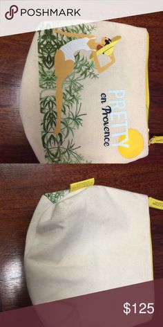 Cosmetics pouch Beautiful artwork on this L'Occitane pouch L' Occitane Bags Cosmetic Bags & Cases