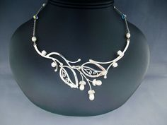 Nature inspired necklace sterling silver leaves pearl wedding bridal. $169.99, via Etsy.