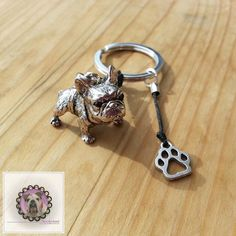 Keychain with figurine of brass with Black Lace French bulldog. Size of the French bulldog 3.1cm x 2.4 cm / 1.22 x 0.94 It carries also a silver