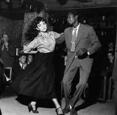 A couple dancing at a nightclub in the 1950s.