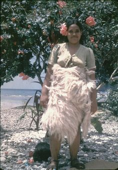 "Young girl wearing 'iesina, the bleached fine mat used to prove ""worthiness"" at a traditional Samoan marriage ceremony. (See Augustin Kraeme..."