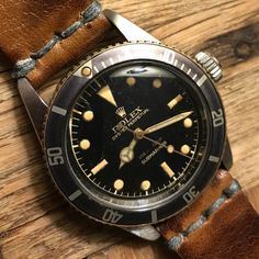 Our #Rolex #Submariner Oyster Perpetual Ref. 6538 from 1958, same model was worn by Sean Connery in Dr.No, Goldfinger & Others. Comes with 1-year warranty,  Movement is Serviced & Working Perfectly, Works 660ft underwater, Bezel is 100% original, Dial is 100% original, Has big crown gilt dial (extremely rare), Band is Horween Leather.