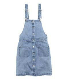 Short bib overall dress in washed stretch denim with adjustable shoulder straps. Pockets and buttons at front.