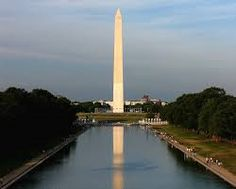 """The Washington Monument, built in honor of America's revolutionary hero and first president, is dedicated in Washington, D.C. The 555-foot-high marble obelisk was first proposed in 1783, and Pierre L'Enfant left room for it in his designs for the new U.S. capital. After George Washington's death in 1799, plans for a memorial for the """"father of the country"""" were discussed, but were adopted until 1832--the centennial of Washington's birth."""