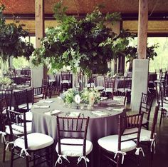 Some of the centerpieces will be tall cylinder vases overflowing with green oak leaves and fall foliages, magnolia leaves, and crabapple branches surrounded by mercury glass votives.