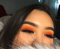 Looks like the sunset is on her eyelids