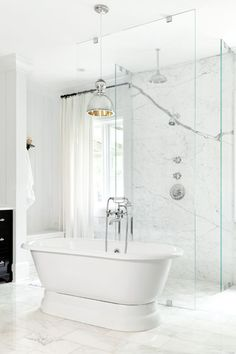 White marble is one of my favorite home staples, and it makes for an especially glamorous bathroom. Mercury Glass Chandelier, Bathroom Tile Designs, Atlanta Homes, Beautiful Bathrooms, Glamorous Bathroom, Master Bathroom, Brass Bathroom, Bathroom Spa, White Bathroom