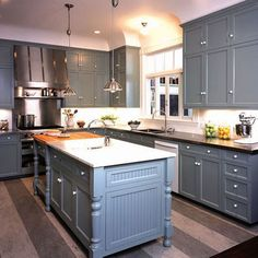 Grey Kitchen Cabinets with black granite instead of white and crystal knobs!!