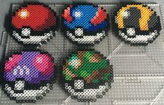 Perlers of the bagsprites of the pokeballs that originally appeared in pokemon Blue and Red (Kanto Region). In order from left to right, top to bottom, they are Pokeball Greatball Ultraball Masterb...