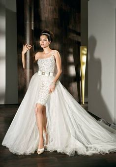 1.One-Shoulder A-line Tulle 2 in 1 Wedding Dress  2.2 in 1 Wedding Dress Features Fully with beads and sequins Mini with Wrap-Around Tulle Train and Beaded(add sequins) Bow Accents at Natural Waist  3.Floor Length Wedding Dress Convertible to Short