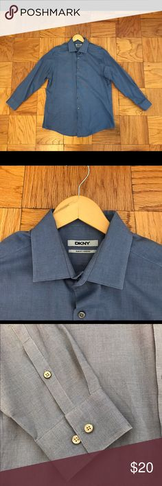 DKNY Slim Fit stretch Button Down Shirt 16.5 32/33 Men's DKNY Slim Fit stretch Button Down Shirt.         Size 16.5   32/33. Color blue.  Mint condition. Worn only once and washed. DKNY Shirts Dress Shirts
