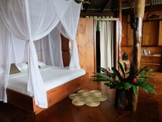 King bed with natural latex and bamboo mattress, luxury bedding and cotton canopy mosquito net. Salisbury House, Wooden Cottage, Wooden Cabins, House Beds, Luxury Holidays, West Indies, King Beds, Luxury Bedding, Canopy