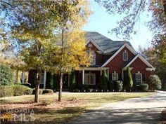 $419,900 This has some good spaces.  Lot/drive seem nice, private.  Has double ovens.  Nice basement space. 1191 Dials Plantation Dr, Statham, GA 30666 — Southern Elegance tucked beyond a winding tree lined driveway.