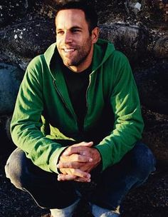 Jack Johnson...love the scruff, love the green hoodie, LOVE his voice... Him though.^^(: