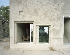"""Completed in 2014 in Potsdam, Germany. Images by Erica Overmeer. Antivilla, the refurbished former German Democratic Republic lingerie factory """"Ernst Lück"""" at the Krampnitzsee, southwest of Berlin, questions the. Mini Clubman, Arno, Concrete Facade, Villa, Architectural Section, Architectural Materials, Reinforced Concrete, Old Building, Loft Spaces"""