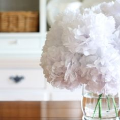 These flowers made from tissue look great. I want to make some.