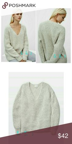 GORGEOUS V NECK KNITTED SWEATER THIS IS SUCH A GORGEOUS V NECK KNITTED SWEATER.  SUPER CUTE AND COMFY!  MILKY COLOR. BOUTIQUE Sweaters V-Necks