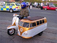 Vespa w/ VW Van Sidecar. Either annoying or brilliant. I can't decide.