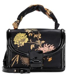 Dries Van Noten - Floral-printed satin shoulder bag - Dries Van Noten's compact shoulder bag is crafted from vibrant  floral-printed satin and features glossy patent-leather trims in a structured design. The refined style is sure to bring a luxe quality to every outfit. Carry yours nonchalantly over your shoulder with a tailored blazer. seen @ www.mytheresa.com