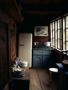 This is a most appealing #kitchen... with the row of windows and quaint decor... The refrigerator looks vintage... <3