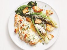 Make a restaurant-worthy chicken Caesar with a little help from your humble broiler and sheet pan. Chicken breasts and homemade croutons get golden in the oven. Charring the romaine adds a new dimension to this dinner standby. Mango Salsa, Tzatziki, Buffalo Chicken, Caesars Salad, Food Network Recipes, Cooking Recipes, Cooking Tips, Sheet Pan Suppers, Chicken Caesar Salad