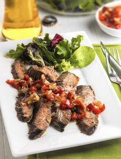 "Top 10 recipes of 2014 have Good Eating staff of Chicago Tribune taking another bite. Here's one: Flying tiger flank steak. Bill Hogan, Chicago Tribune ""We kicked off grilling season with four delicious ideas for flank steak, each with a marinade and sauce. This was our favorite. (Food styling by Corrine Kozlak.)"" http://www.chicagotribune.com/lifestyles/food/ct-food-0107-best-recipes-2014-20141231-story.html"