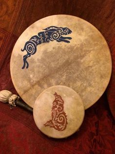 Deerskin hare and wolf drums with channelled designs by Taz Thornton (www.firechild-shamanism.co.uk). Painted with woad and ochre-based acrylic.